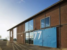 ector hoogstad architecten convert steel plant into IMd consulting engineers' offices in rotterdam, the netherlands