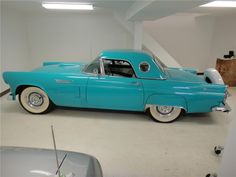 1956 Ford Thunderbird Convertible. My favorite all time car.  I'd like it in red though.....