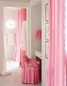 Fabric keeps clothing under wraps -- and dust-free -- in a pink and white dressing room....(Dan Piassick Photography)