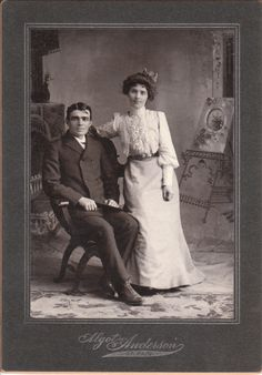 This photograph features an attractive young couple posing at the studio belonging to Algot Anderson in St. Paul, Minnesota.