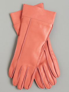 Pretty coral gloves. I'd love these with a camel hair coat.