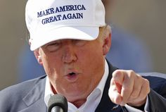The Trump Foundation paid $12,000 for the helmet, which Trump later posed with, at a Susan G. Komen auction.