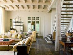 Love all the details in this living space - ceiling, floors....great set up to look out onto the lake