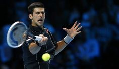 Nole Djokovic colpisce di dritto. Action Images