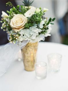 Pretty arrangements: http://www.stylemepretty.com/2015/03/05/soft-outdoor-wedding-with-southern-charm/ | Photography: Julie Cate - http://juliecate.com/