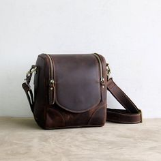 Vintage Small Leather DSLR Camera Bag We use selected thick cotton waxed canvas, quality hardware and cotton lining to make the bag as good as it is. The inside removable padded insert bag can fit two