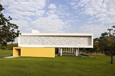 This U-shaped home inGoiania,Brazil, dubbed Patio House, is simple yetinteresting, functional yetstylish, modern yetwarm.