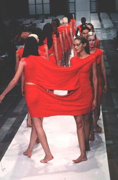 So I don't lose my friend in the crowd....I guess? Or fashion's version of the human centipede