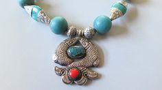 Vintage tribal ethnic Tibet, Nepal Kathmandu turquoise beads and silver repousse fish pendant necklace