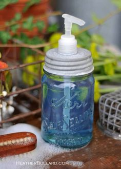 """To repurpose a mason jar into a soap dispenser, measure and mark the center of the jar's lid.    Using a ½"""" high-speed steel drill bit (about $10; local hardware store), drill a hole to fit the width of a soap dispenser pump. We used pumps from used bottles of lotion we were about to throw out.    Fill the jar with liquid soap, screw the lid back on, and insert the pump ($3.75 each, onedreamdesign.com). You may need to trim the bottom of the pump to fit your jar."""