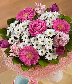 Candy Floss Posy An Aqua Rose Is Surrounded By Tulips Hyacinth Chrysanthemums And