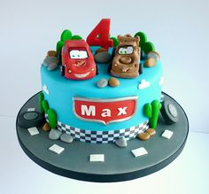 Cars themed birthday cake with Mater and Lightning Mcqueen via https://www.flickr.com/photos/swirlsbakery/13040146903/in/photostream/