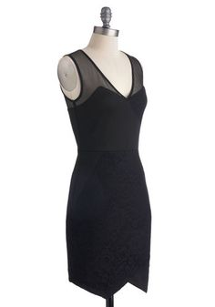 "This dress is sleek and sexy without being TOO sexy. The perfect definition of ""little black dress"". It has asymmetrical qualities and I love the hemming as well as the juxtaposition between the the sleeves (or straps) and the rest of the dress."