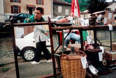 Alex Webb FRANCE 2000 Lorraine region. Meuse department. Village of Sommedieu. During a garage sell.