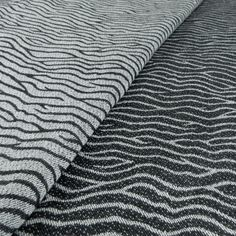 Kimata, Greek for little waves, is a new Didymos model reminding of waves dancing up and down and the prints they leave on the beach. With a weight of only 210 g/m² it is well suited for babywearing also dur. Wave Dance, Woven Wrap, Baby Wraps, Baby Wearing, Animal Print Rug, Monochrome, Organic Cotton, Black And White, Fabric