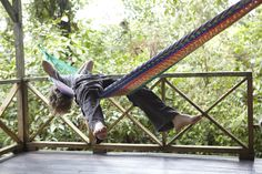 Teen boy relaxing on a hammock on a rustic porch  © Laurie Frankel Photography