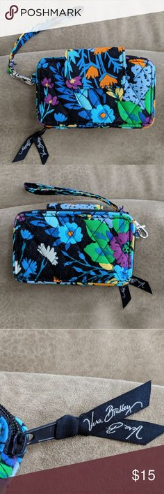 Vera Bradley Wallet/Phone Holder Wallet with phone pocket in Midnight Blues print. Snap closure on phone compartment, not big enough for any XL phones (my Pixel 2 is too big). Zippered wallet pocket with card slots, ID slot and zippered coin pocket. Unused, no signs of wear and tear. Vera Bradley Bags Wallets
