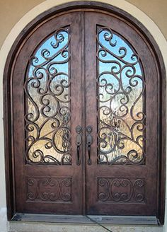 Wrought iron doors are indeed a style from the past. With creativity, you can make your house look more sophisticated with the wrought iron front doors. House Entrance, Entrance Doors, Grand Entrance, Iron Front Door, Front Doors, Front Entry, Front Porch, Cool Doors, Unique House Design