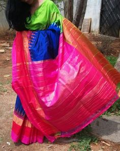 Royal blue ikkat silk saree with contrasting green and pink border with zari