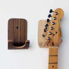 Guitar hooks. finally ones that look like they belong in the house and not the garage. classy :)