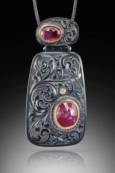 David Giulietti - Oxidized sterling silver pendant with engraved European gun scroll. Rose cut pink sapphire (lower) and rose cut pink tourmaline (upper) in 18ky settings and accent diamond