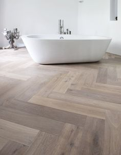 Wood look tile set in a herringbone pattern. Shop for all of your wood look tile needs at the Quality Flooring 4 Less Website: http://www.qualityflooring4less.com