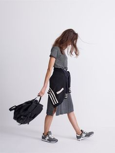 madewell whisper cotton crewneck tee and striped side-slit midi skirt, bomber cardigan sweater + madewell x saucony® dxn trainer sneakers worn by madewell graphic design whiz marie.