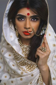 Bold bridal makeup. Love the red lips and statement jewellery. #ring #necklace
