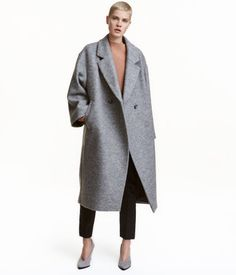 Gray melange. PREMIUM QUALITY. Oversized, double-breasted, calf-length wool coat. Dropped shoulders, wide sleeves, and diagonal front pockets. Lined.