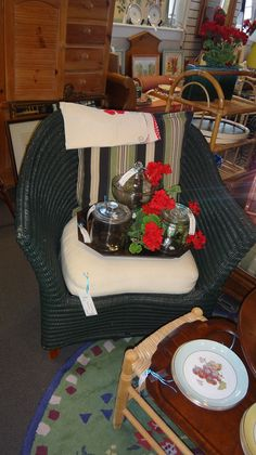 A dark green wicker chair.  Perfect for your summer lake cottage.   Like us on Facebook to see our weekly arrivals:  https://www.facebook.com/pages/The-Courtyard/419086284795890