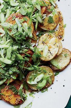 Chicago chef Stephanie Izard grills sliced potatoes in butter to give them an amazing crust, then dresses them with a supertangy mustard seed vinaigrette, fresh scallions and celery. #foodandwine #comfortfood #comfortfoodrecipes