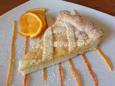 La crostata all'arancia è un delizioso dolce di pasta frolla con crema all'arancia. Un dolce unico dal profumo intenso ma dal sapore delicato