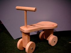 Beautiful Artisan non-toxic wooden ride on toy with functional wheels. Wooden Ride On Toys, Wooden Scooter, Baby Ride On, Natural Baby, Natural Kids, Toddler Car, Woodworking For Kids, Wooden Diy, Diy Toys