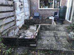 Hergebruik van oud terras (grindtegels en bakstenen)