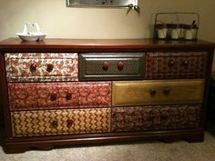 an old dresser upgraded by using fabric and mod podge.