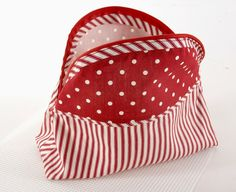 My bag measures 8″ tall and 8″ wide, I drew around a plate to make the curve. The cut out squares in the base are 1″ along the sides.lining on the left, outer on the right. I made my own bias tape strips The strips went in between the two front panels I then... Read more »