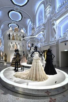Gowns by John Galliano and Maria Grazia Chiuri in the Dior exhibition at Les Arts Décoratifs. In the center, Christian Dior's Junon dress.