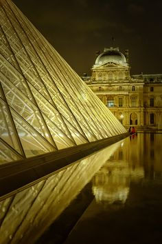 The Louvre Palace at night is one of the most beautiful and mesmerizing sights.