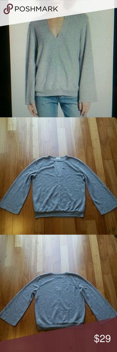"""PROJECT SOCIAL T KEYHOLE SWEATSHIRT PULLOVER Very good condition. the cozy ,fleecy texture of this relaxed sweatshirt will tempt you to cuddle up at home,but bell sleeves and a keyhole cutout make the style too cute to stay in.flared long sleeves. 50% cotton 50% polyester. 23"""" length 19"""" armpit to armpit. All measurements are taking with the garment lying flat. ??17. project social t Sweaters"""