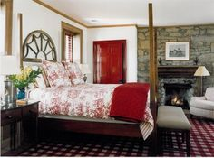 Decorating with Red - country style bedroom with toile comforter, checked rug, and red door.