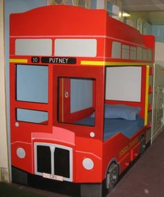 Double Decker Bed. Inside have hovers with kids products. Pillows on floor like a play area so Mom can shop?