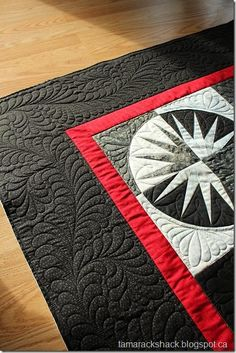 Mariner's compass; love the quilting pattern on this one.