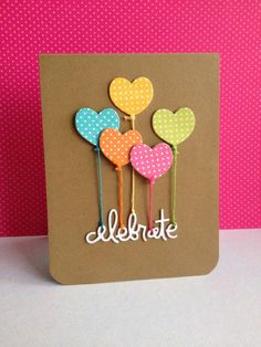 Heart-shaped balloons stamped with colorful dotted patterns are tied with matching string and popped up on kraft paper. Add a simple die cut sentiment (celebrate!) for an easy handmade birthday card.