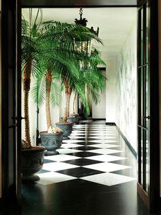 Hallway design (see more) #lake #como #villa #hall #way #decor #floor #tiles #checkered #black #white #palms #plants #Home #design #italy #Inspiration