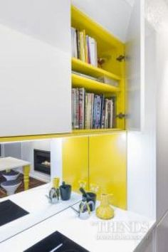 Splashes of bright yellow Resene Golden Dream add a whimsical touch to this Modernist kitchen