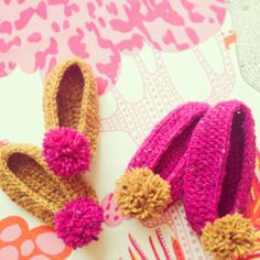 http://thesmallestsheep.co.uk/products-page/new-baby/crochet-baby-pom-pom-slippers/