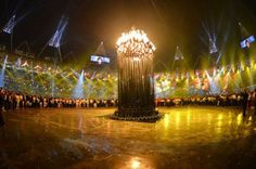 """Photo #6: July 29, 2012- UK - torch-206x310    LONDON – Disappointed fans criticized London 2012 organizers on Sunday, accusing them of staging a """"disappearing act"""" with the Olympic flame."""