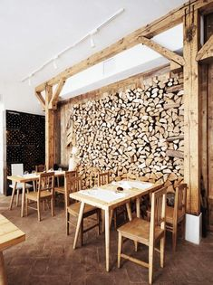 A wall of wood storage in a restaurant.