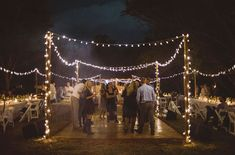 Outdoor evening reception with string lights and an open dance floor.