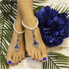 Pearl barefoot sandals with sapphire jewels. Our barefoot sandals add a little Vintage romance to your royal blue beach wedding. Lovely is perfect word to describe our sapphire blue barefoot sandals w